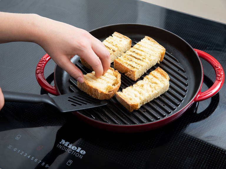 Cut bread to desired size. Toast bread in grill pan over medium-high heat.