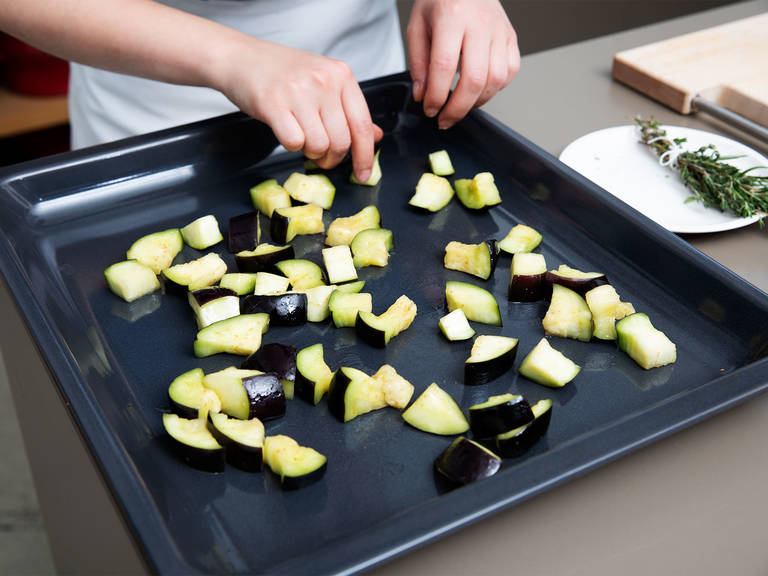 Squeeze out excess water from the eggplant, massage it with a part of the olive oil and spread out onto a parchment-lined baking sheet. Transfer to the oven and let roast for approx. 20 min. at 200°C/390°F.