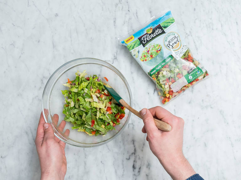 Add Mexican salad mix to the bowl and gently toss to combine.
