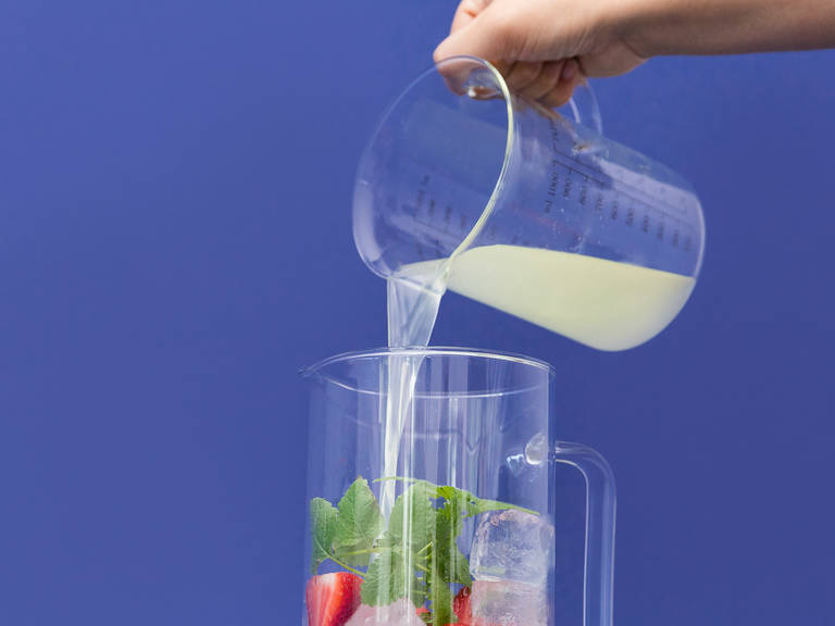 Add ice to a large pitcher. Place sliced strawberries in the pitcher and lemon balm leaves, if using. Pour in lemon juice, soda water, and strawberry puree. Stir well to ensure sugar is fully dissolved. Enjoy!