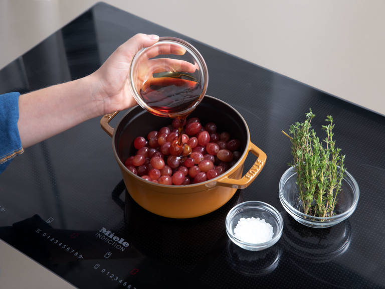 Wash grapes and add to a pot set over medium-high heat along with the maple syrup, thyme, and a pinch of sea salt. Bring to a boil and let simmer on low heat for approx. 10 min., or until grapes are soft and have burst. Set aside and let cool.