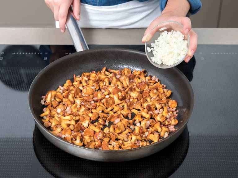 Heat some oil in a large frying pan and fry chanterelle mushrooms for approx. 5 min. Add garlic, onion, and bacon and fry for approx. 3 – 4 min.