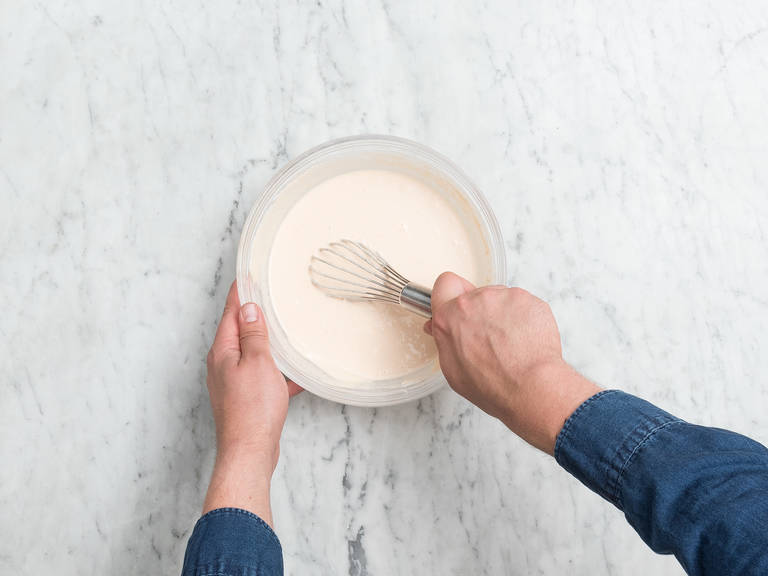 Add rice flour, lentil flour, baking soda, and salt to a bowl. Add part of the yogurt and water and whisk until a smooth batter forms. Cover with a kitchen towel and allow to rest in the fridge for 1 – 2 hrs.