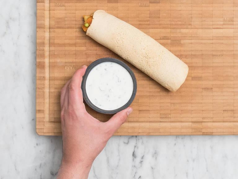 Fill dosa with potato filling and carefully roll up. Serve with the mint-yogurt sauce. Enjoy!