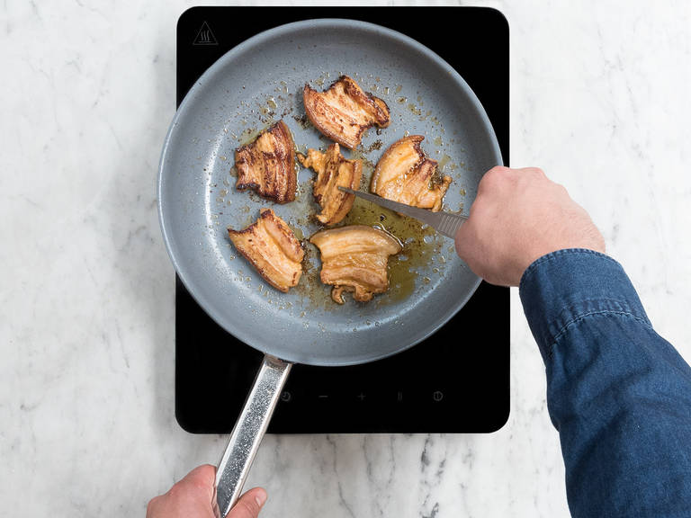In a frying pan, heat some vegetable oil over medium-high heat. Add marinated slice pork belly and sear for approx. 2 – 3 min. on each side.