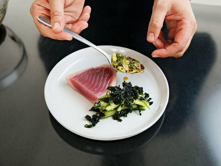 Cut tuna in slices of about 0.5-cm/0.20-in. thick. Serve with the tataki sauce and cucumber-seaweed salad on the side. Enjoy!