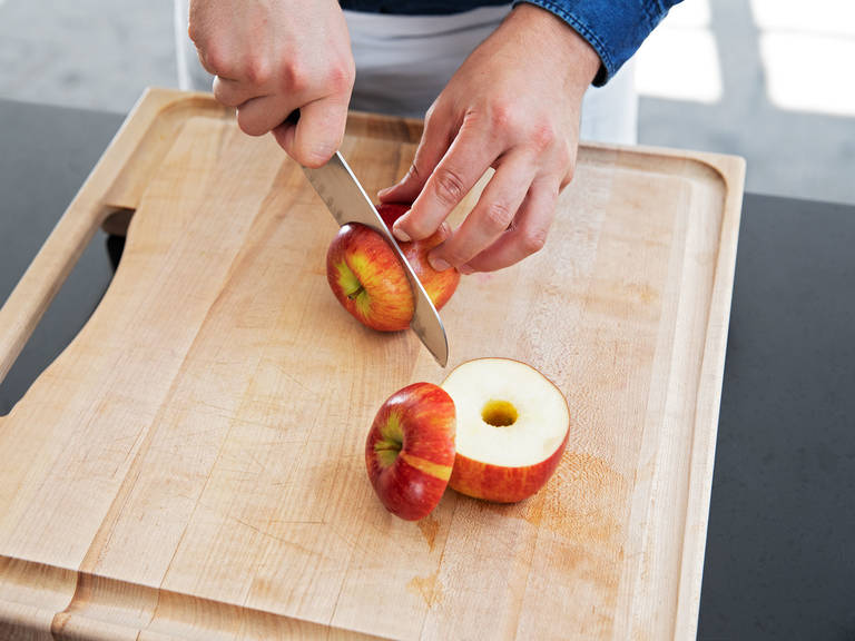 In the meanwhile, rinse the apples under cold water and pat dry. Cut off the top. Carefully core the apples, leaving them whole and making sure that the cavity is around 2-cm/ 0.8-in. diameter.