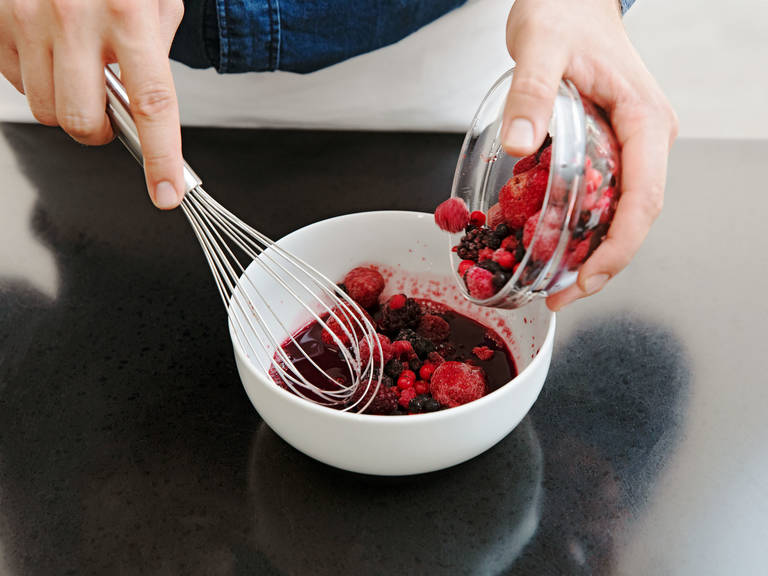 For the berry compote, mix cherry juice, sugar, and starch in another bowl. Add half of the frozen mixed berries.