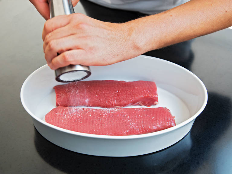 Wash lamb saddle and pat dry with paper towels. Remove any silver skin and unnecessary fat. Transfer to a microwave-safe baking dish and season with salt and pepper.