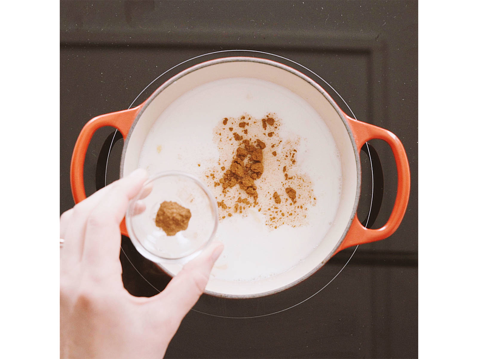 Add milk, water, pinch salt, maple syrup, cinnamon, and nutmeg to pan and bring to a simmer over medium heat.