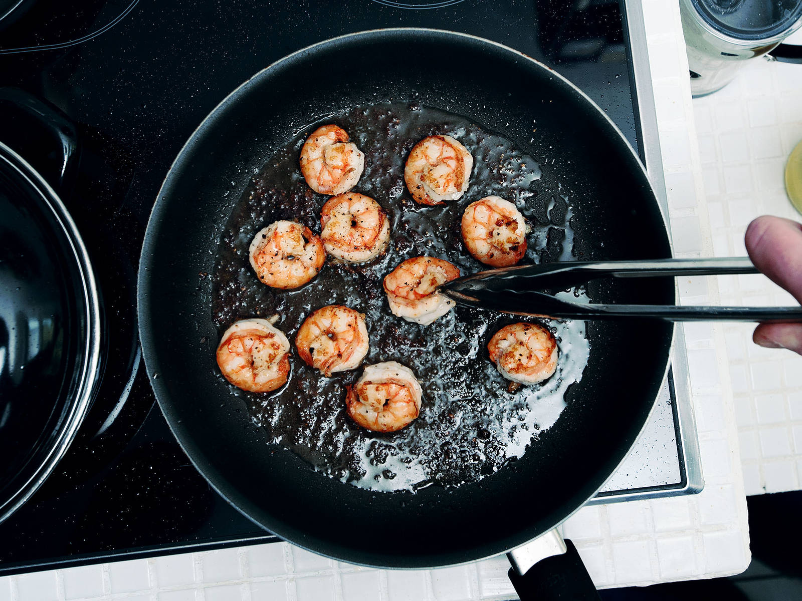 Peel and devein shrimp, add to a frying pan, and sauté in vegetable oil over medium-high heat with salt and pepper. Cook for approx. 2 – 4 min., until shrimp turn pink, then remove from heat and set aside.