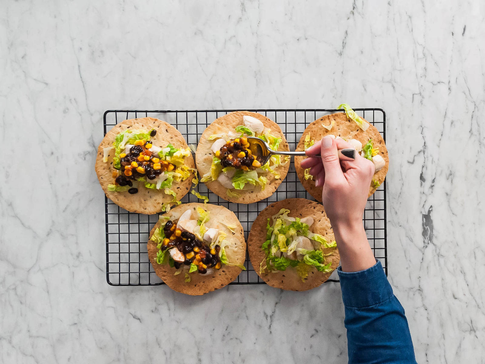 Top each tostada evenly with chicken, lettuce, and salsa mixture. Enjoy!