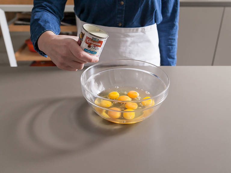 Preheat oven to 190°C/350°F. Spray muffin tin with cooking spray. Chop bell pepper and spoon into each cup. Beat eggs and evaporated milk in large bowl. Season with salt and pepper.