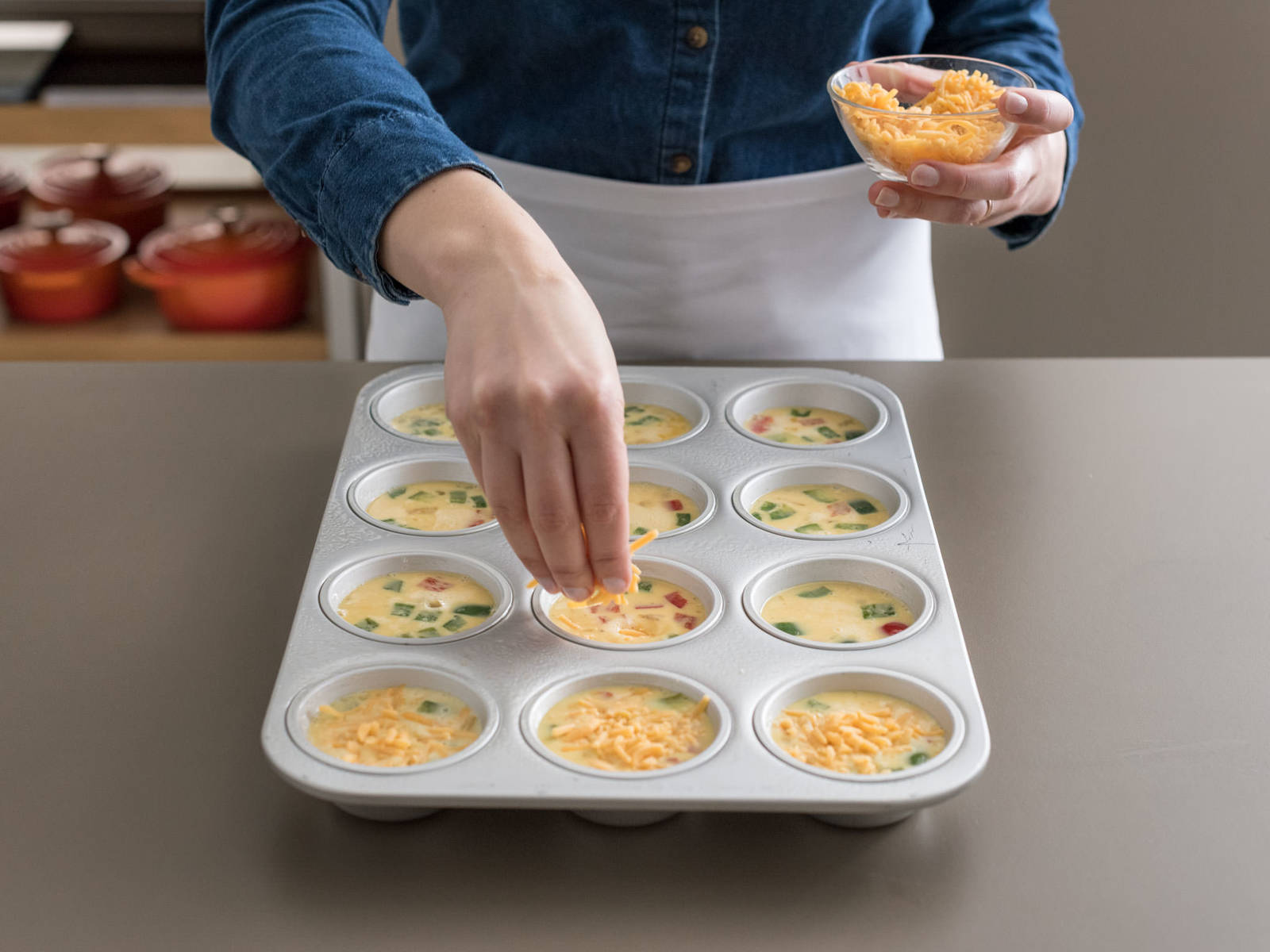 Pour egg mixture into cups, filling each three-quarters of the way full. Sprinkle with cheese.