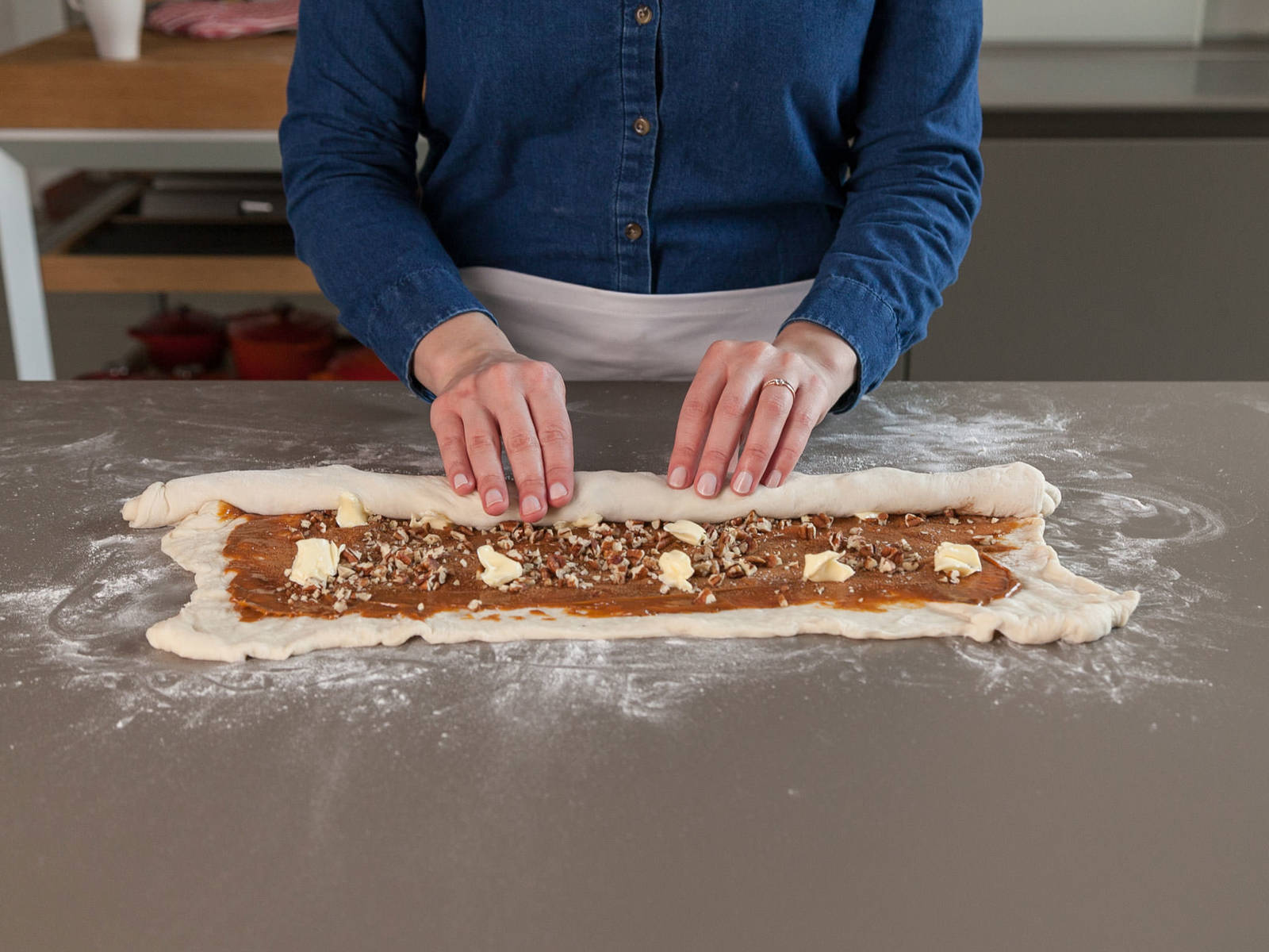 From the 35 cm/14 in. side of dough, roll up tightly to form a log. Seal edges with water.