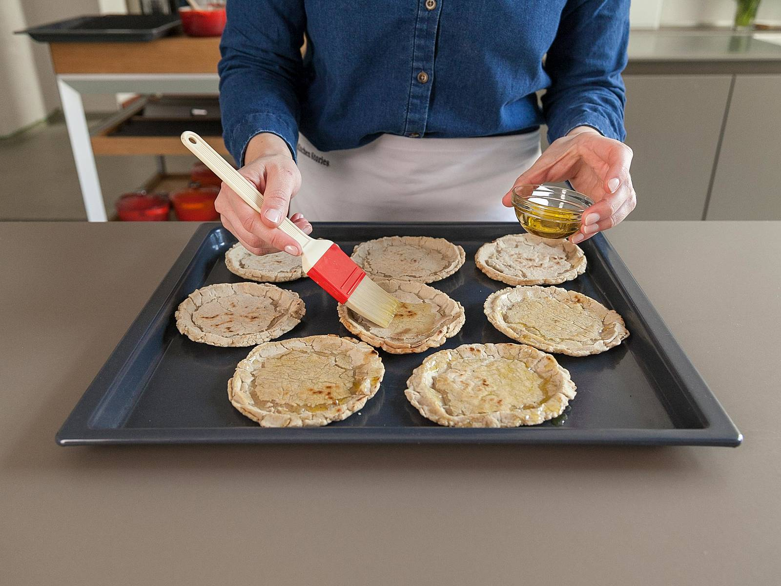 Meanwhile, transfer sopes to a baking sheet and brush both sides with olive oil. Toast at 200°C/400°F oven for approx. 10 – 12 min.