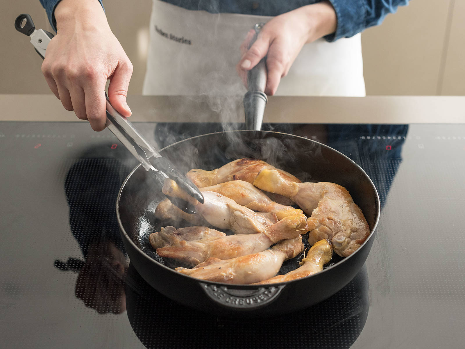 Spray large frying pan with cooking spray. Brown chicken on all sides over medium heat. Place chicken in slow cooker in a single layer.