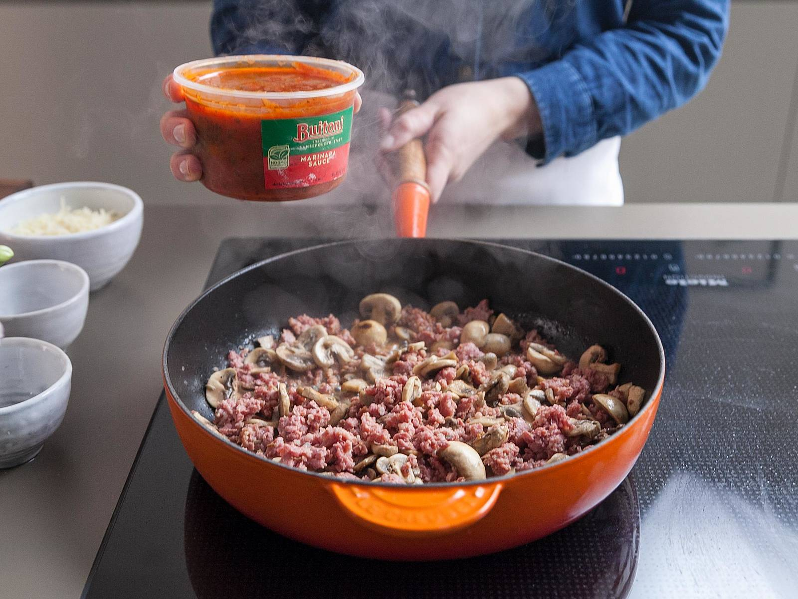 Add wine, stirring to loosen browned bits from bottom of pan. Add tomato sauce and cook, stirring occasionally, until heated through. Remove from heat.