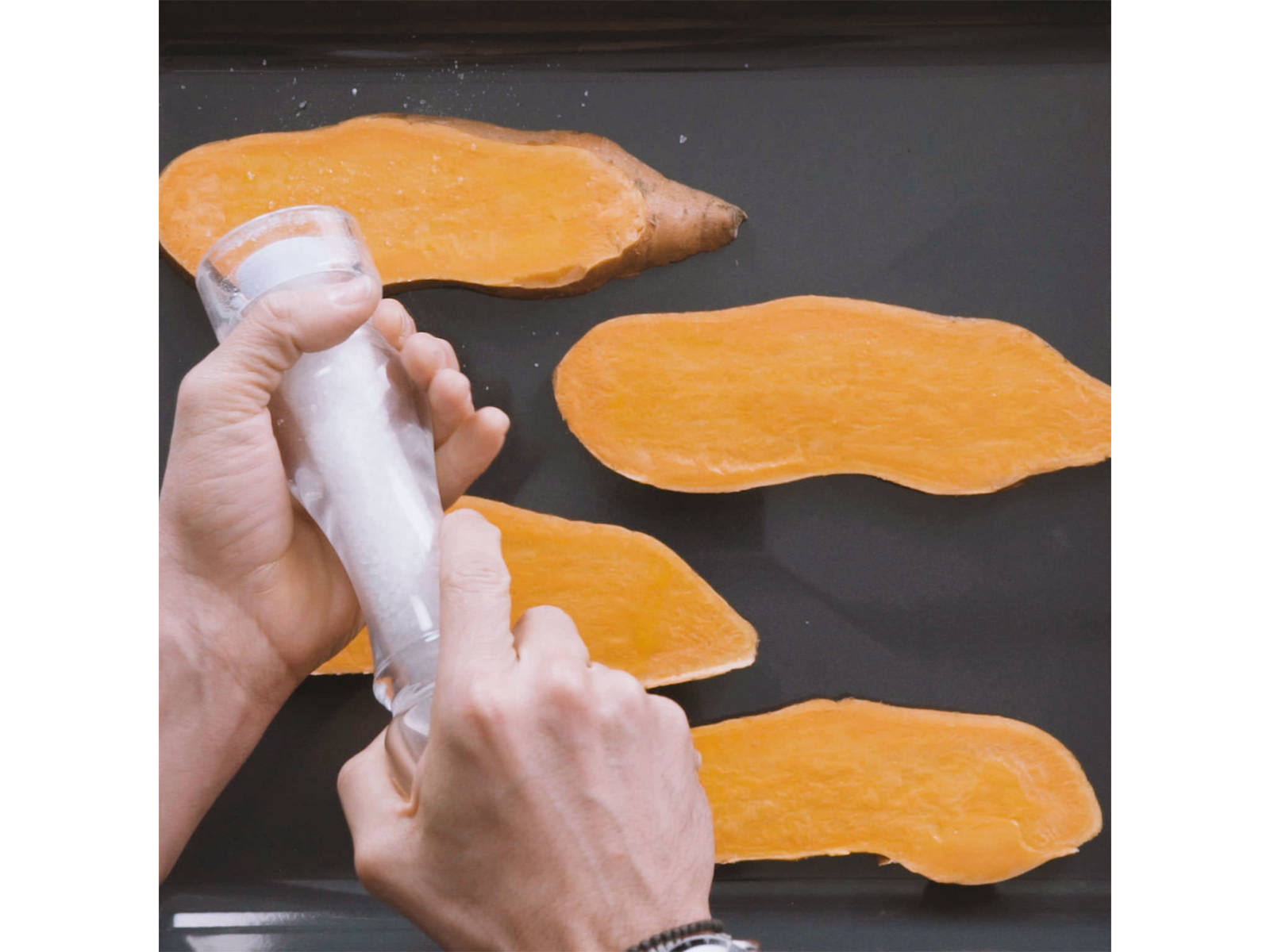 Preheat oven to 180°C/355°F. Cut sweet potato into 1/3-in. thick slices and transfer to a parchment-lined baking sheet. Brush oil on both sides of slices and season with salt. Transfer to oven and bake for approx. 15 min.