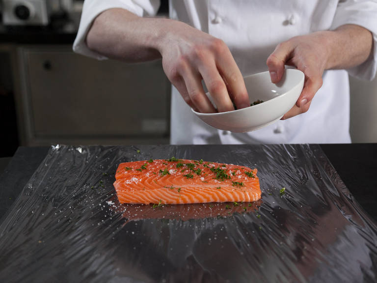 Remove salmon skin from fillet. Season salmon with salt and finely chopped dill. Transfer salmon to a sheet of plastic wrap, wrap, and freeze overnight.