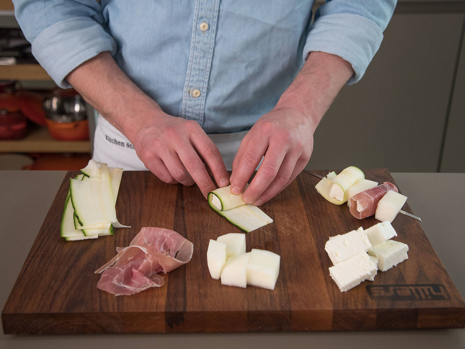 Roll half of the feta cubes in zucchini slices, using one feta cube per slice of zucchini. Roll the remaining feta cubes in slices of prosciutto.