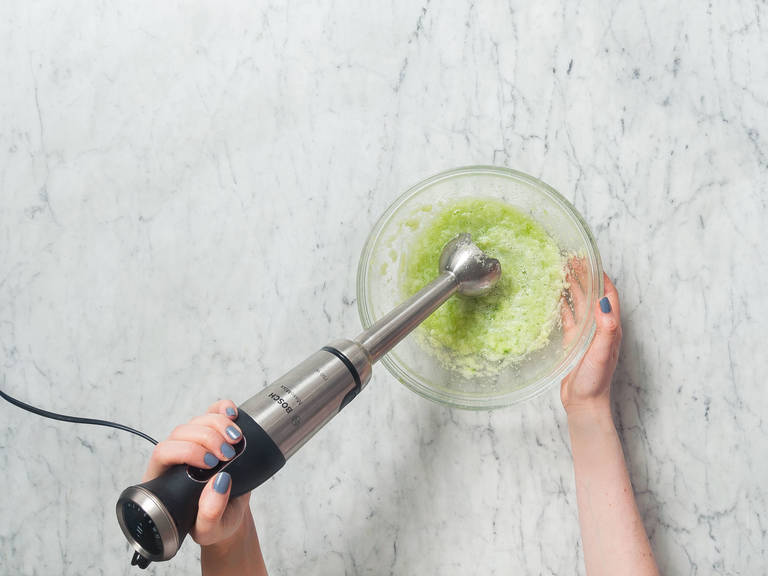 Peel cucumber and cut into bite-sized pieces. Add to a mixing bowl and purée. Then, pass through a sieve into another bowl in order to filter out any cores.