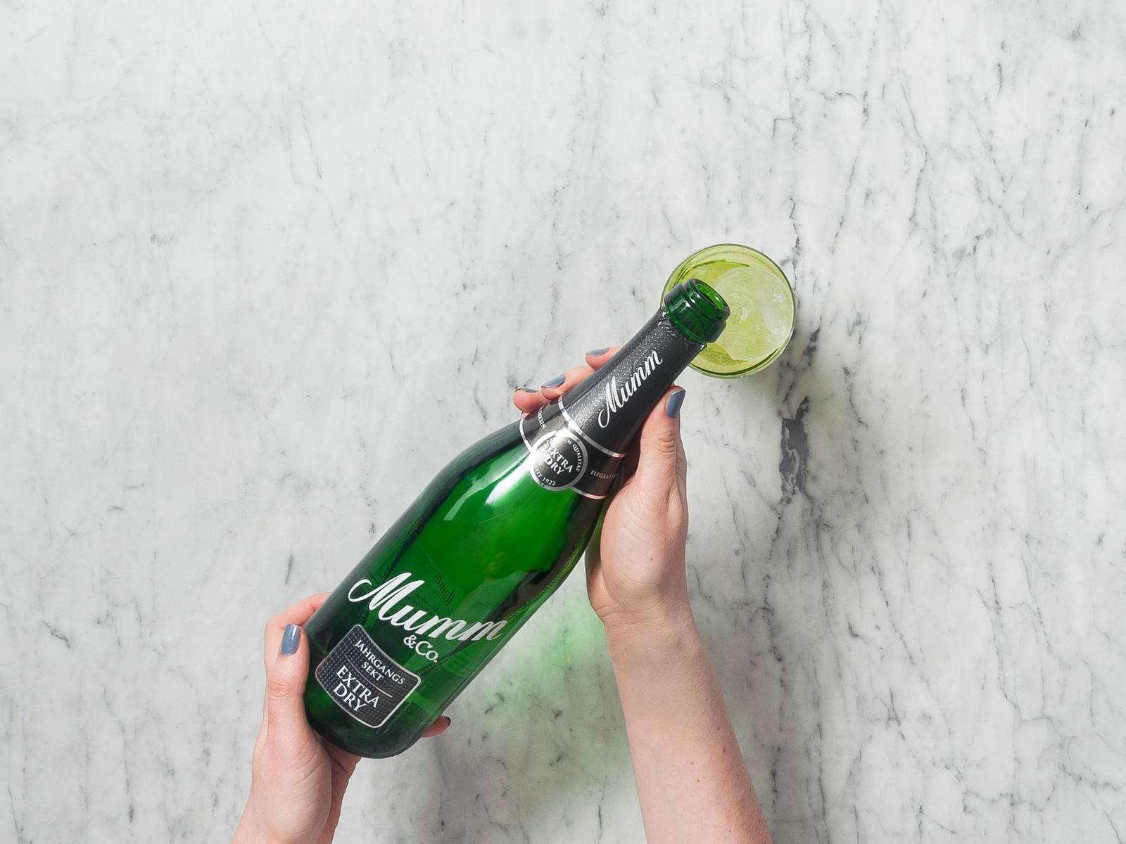 Arrange cucumber slice in a serving glass. Add cucumber water, ginger syrup, and lemon juice and stir. Fill glass with ice and pour over extra dry sparkling wine. Garnish with lemon peel. Enjoy!