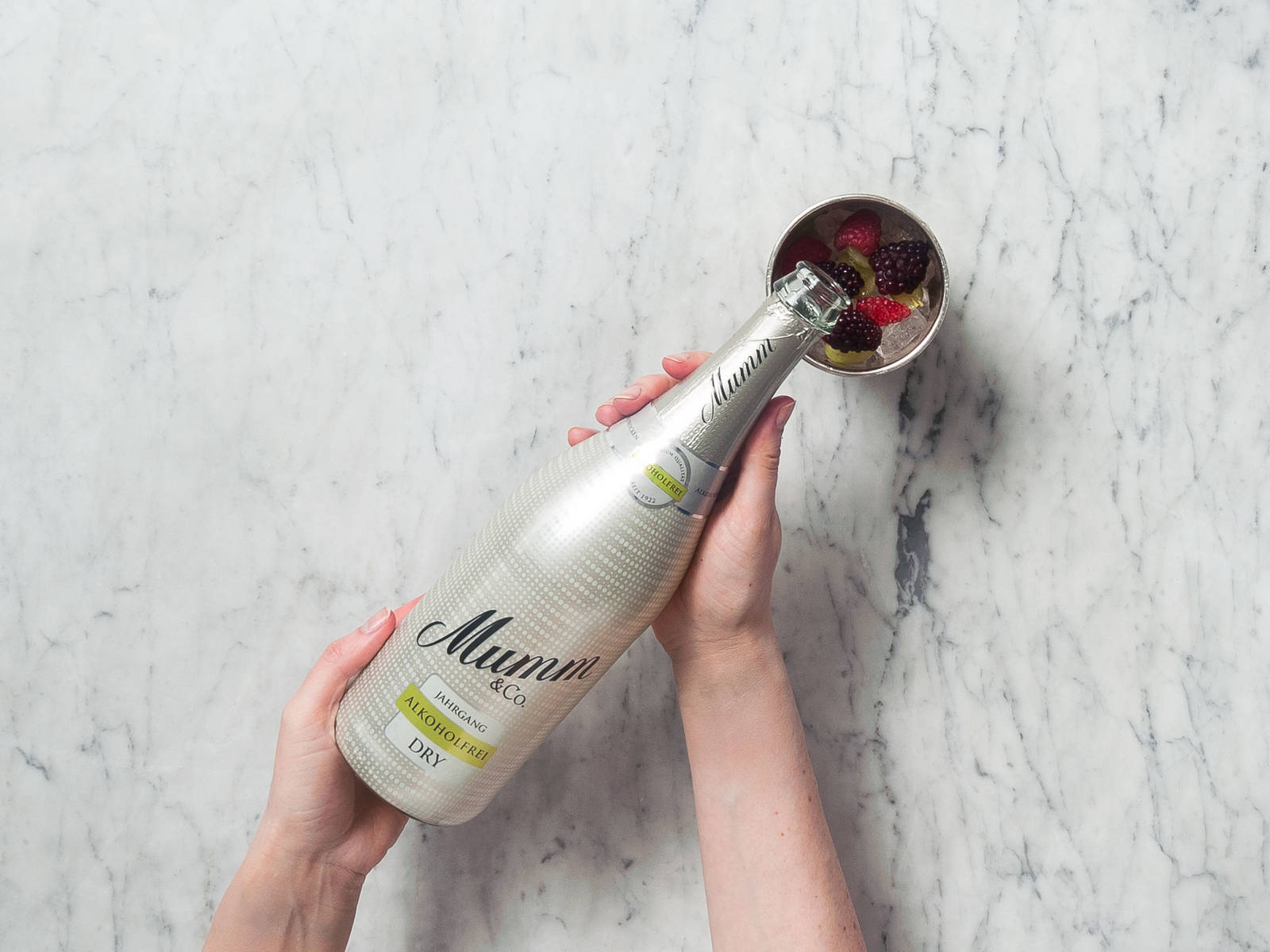 Fill glass with non-alcoholic sparkling wine.