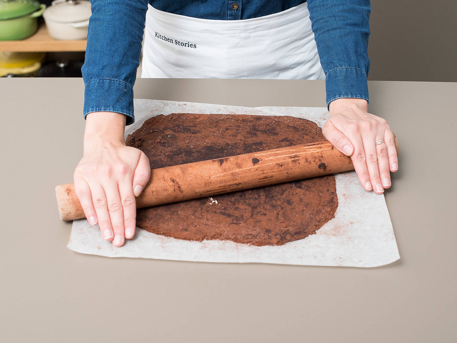 Line a springform pan with parchment paper, lightly grease with butter, and set aside. Preheat oven to 180°C/350°F. Dust a sheet of parchment paper with cocoa powder and roll out about 2/3 of the dough into a circle slightly larger than the mold. Transfer to the prepared springform and press dough to fit, creating a 2 cm/0.75 in. high edge on the sides.