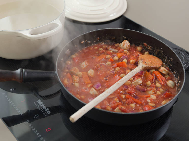 Add tomatoes and season with salt and pepper. Let simmer for approx. 10 – 15 min., uncovered. In the meantime, bring water to a boil in a large saucepan, add salt, and cook penne according to package instructions, until al dente.