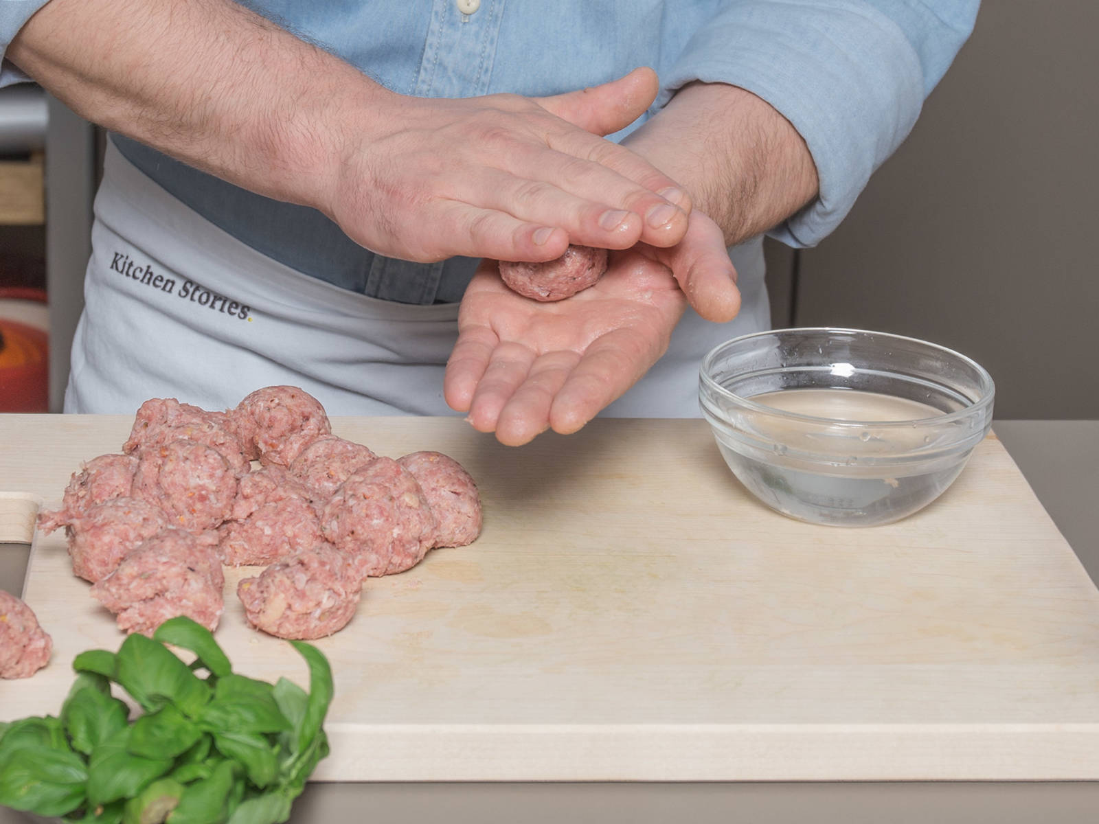 Transfer the ground pork and beef to a large mixing bowl and add sautéed garlic and shallots, chili flakes, oregano, breadcrumbs, and milk. Season with salt and pepper to taste. Stir well and form walnut-sized balls with wet hands. Transfer to refrigerator to rest.