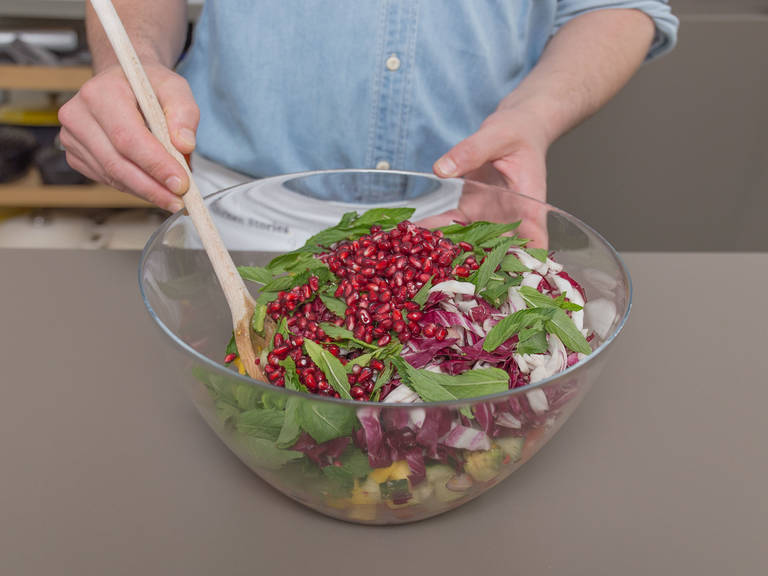 Deseed pomegranate and add pomegranate seeds, pulled chicken, and mint to salad. Mix and toss with some dressing. Enjoy!