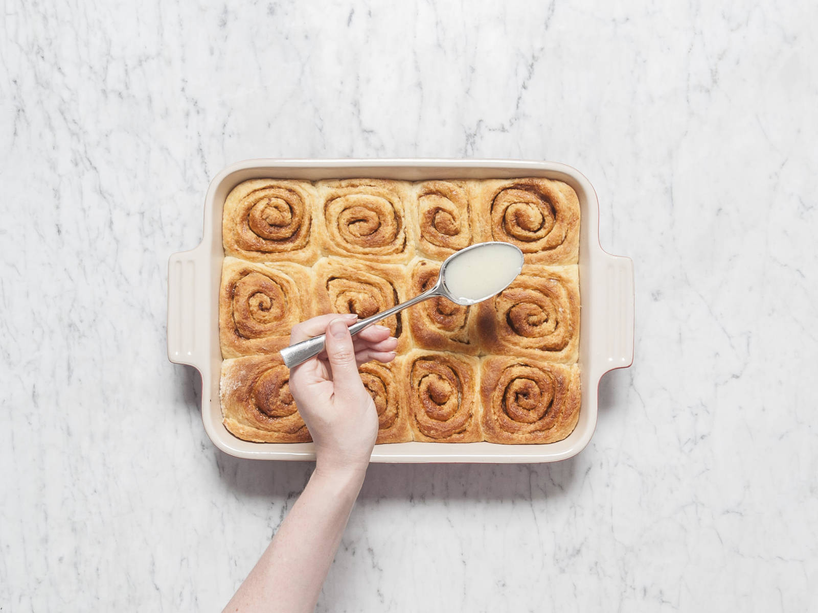 In the meantime, add confectioner's sugar, remaining milk, remaining vanilla bean seeds, remaining salt, and cream cheese to a small mixing bowl and stir to combine. Drizzle over lukewarm cinnamon buns and enjoy!