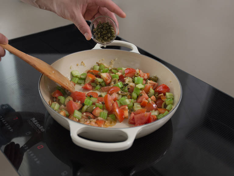Heat up half of the olive oil in a large pan with a lid. Sauté onions and garlic for approx. 1 min. on medium-high heat, or until translucent. Add celery and sugar and sauté for approx. 2 more min., then add tomatoes, olives, and capers. Reduce heat, cover with lid, and leave to simmer for approx. 15 min.