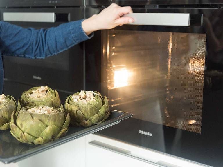 Bake artichokes at 200°C/400°F for approx. 10 – 15 min., or until cheese is bubbly and breadcrumbs are golden brown. Season with salt and pepper to taste. Drizzle with honey. Enjoy!