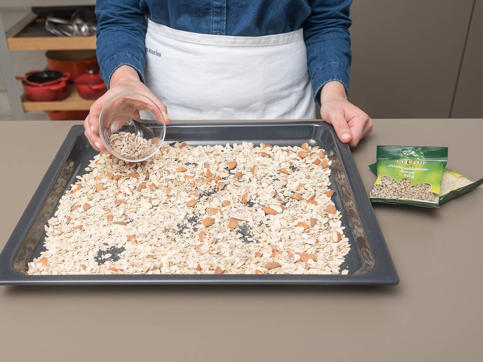 Roughly chop almonds and spread over a baking sheet with the rolled oats, flax seeds, and other nuts and seeds. Toast for approx. 12 min. on the middle rack of the oven at 180°C/350°F until golden brown and fragrant.
