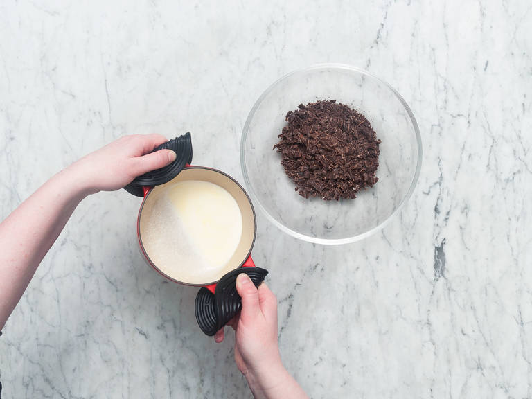 Chop chocolate and add to a bowl. Scald cream in a small saucepan and pour over chopped chocolate. Stir to combine, then let cool at room temperature.