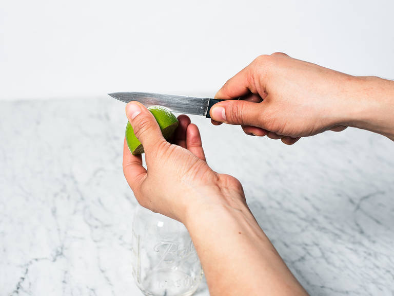 Remove seeds for lime half and score peel 3 times.