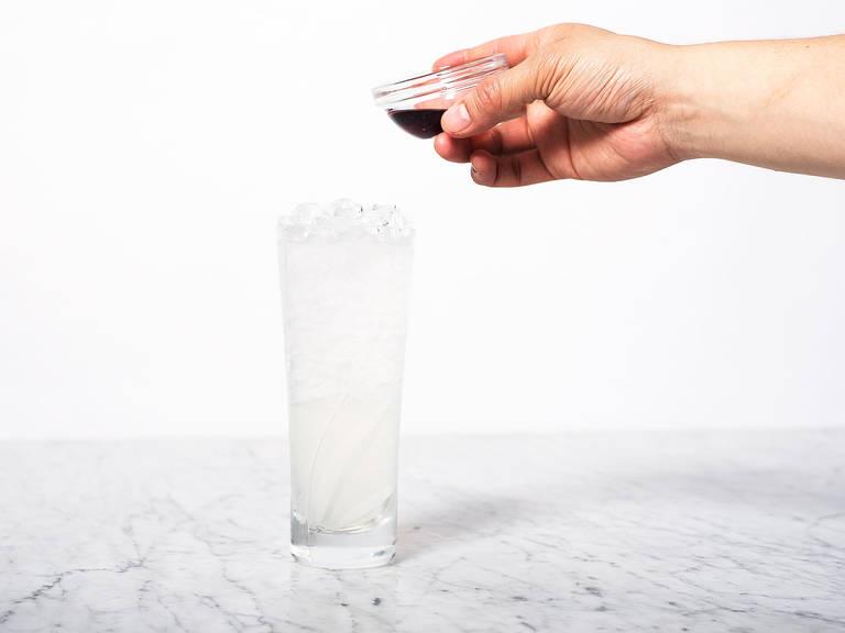 Pour raspberry liqueur over the mixture.