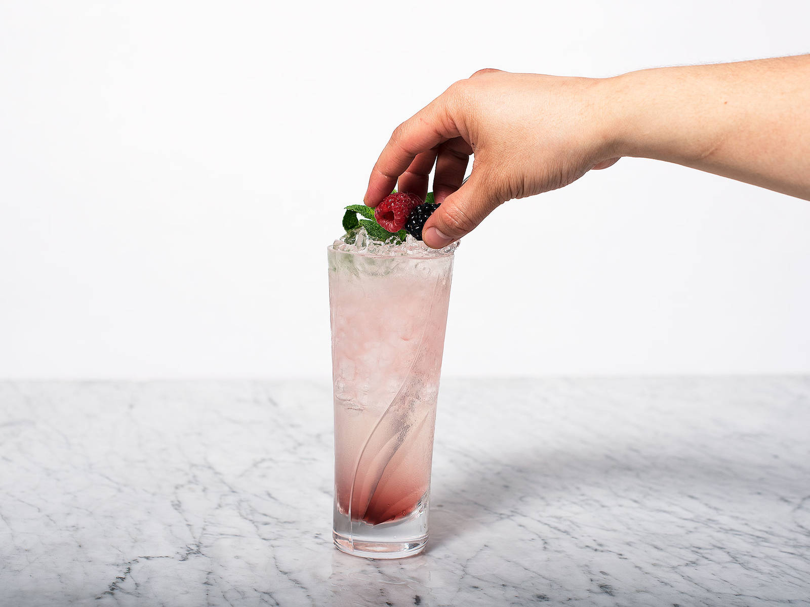 Garnish with mint and berries. Serve with a straw and enjoy!