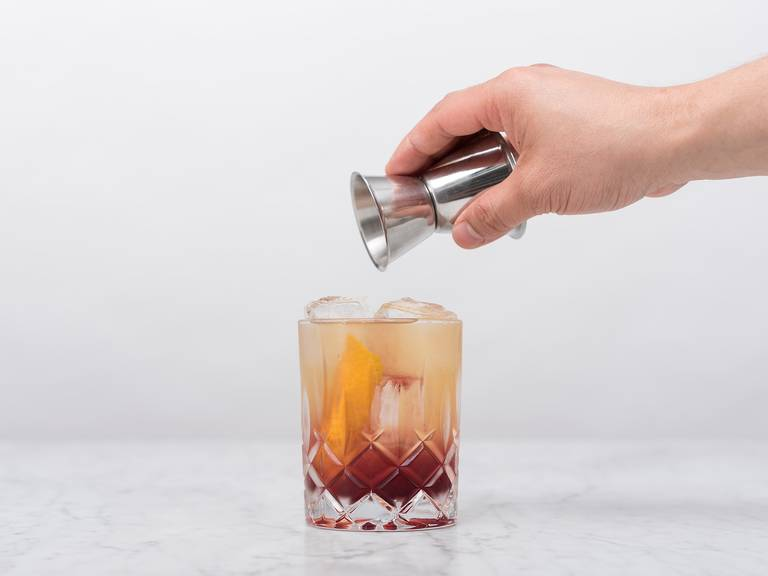 Top with Port wine and orange peel for garnish. Stir gently. Enjoy!