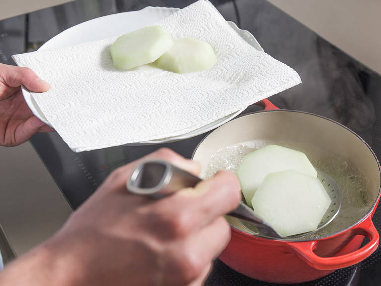 In a large pot of boiling water cook kohlrabi for approx. 5 – 6 min. Drain and transfer to a paper towel-lined plate to dry.