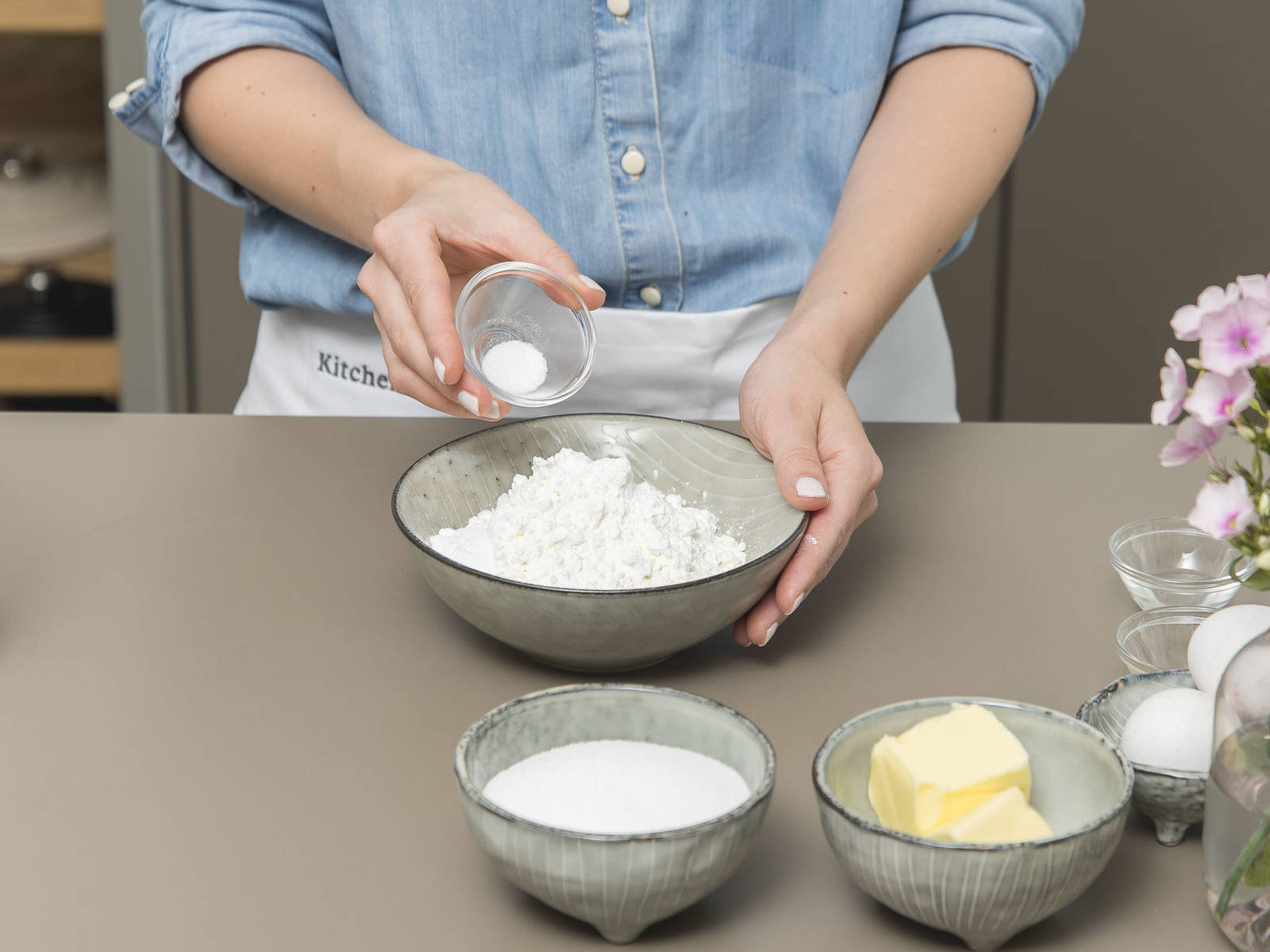 Preheat oven to 175°C/350°F. Line cupcake tins with liners. Combine flour, starch, baking powder, and some of the salt in a bowl and set aside.