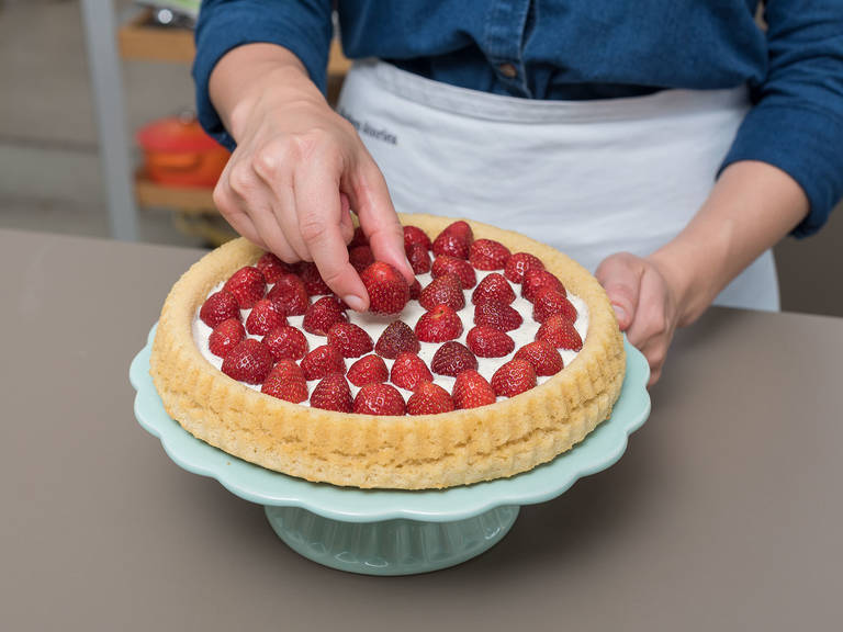 Place a plate over the cooled baking pan and invert the cake onto the plate. Spread the mascarpone mixture over the cake and place the strawberries on top. Sprinkle with toasted, sliced almonds and decorate with mint leaves. Slice and enjoy!