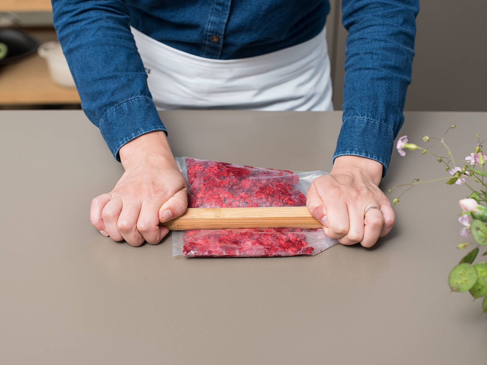 Use a rolling pin to mash up raspberries in a sealable plastic bag and add to popsicle molds, approx. 1 tbsp. per mold.