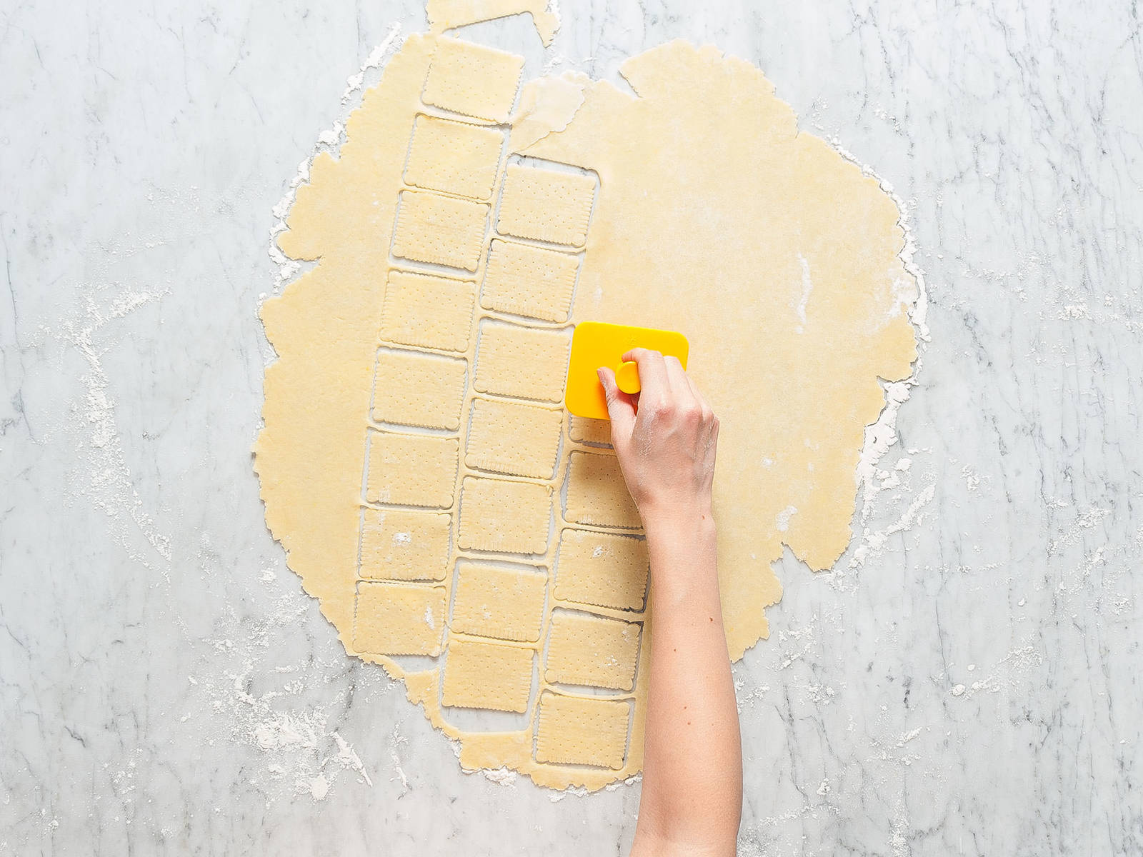 Preheat oven to 180°C/350°F. Flour working surface and roll out dough until approx. 2-mm/0.1-in. thick. Use a cookie cutter to cut out cookies, then brush them with milk.