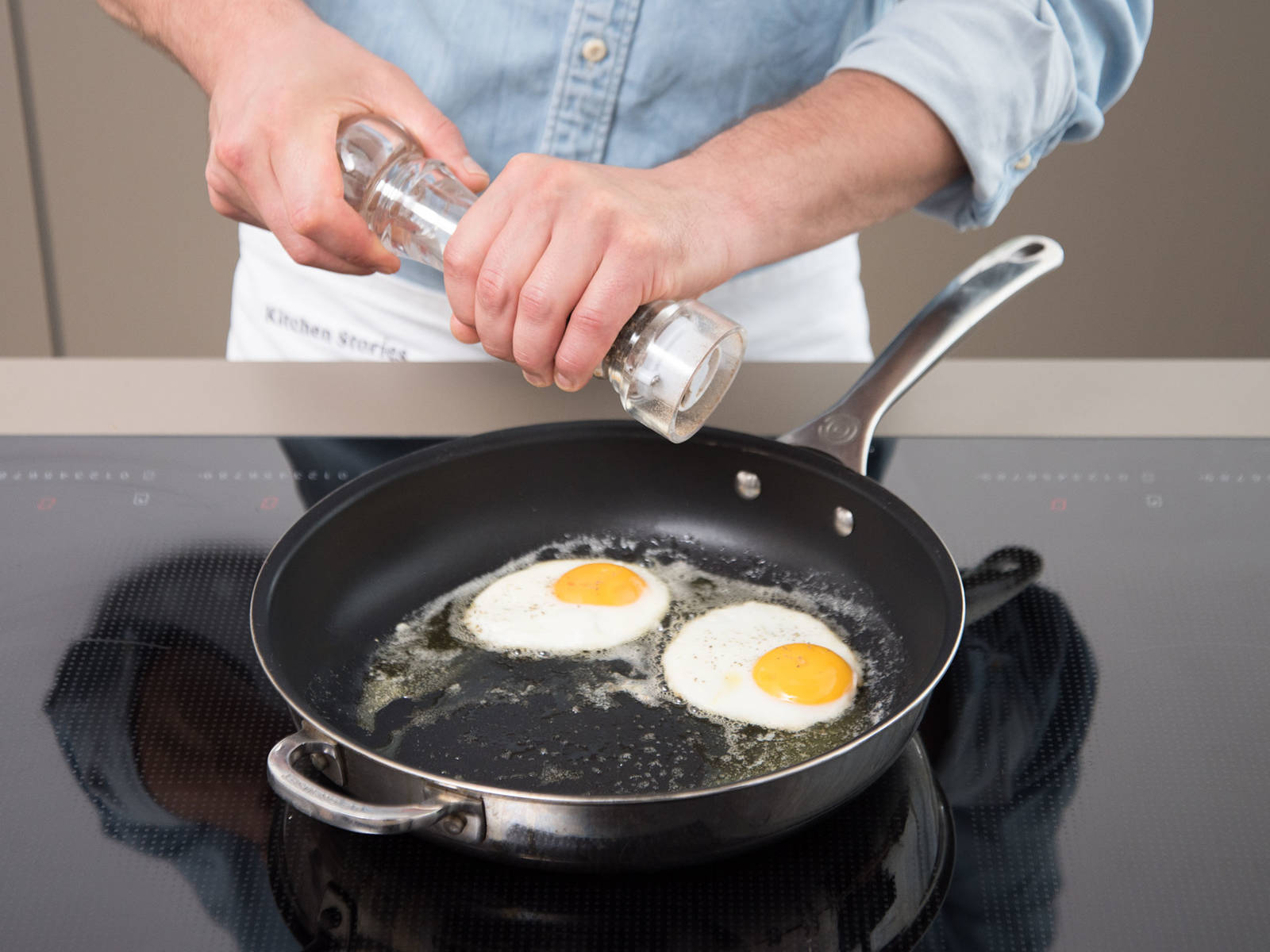Crack eggs and gently drop into the same pan. Cook over medium heat for approx. 3 – 4 min., or until desired doneness, and season with salt and pepper. Serve fried egg on top of meatloaf and alongside potato salad and extra mustard. Enjoy!
