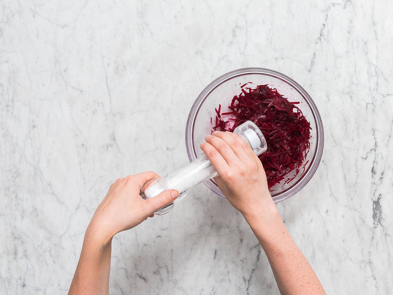 Preheat oven to 220°C/425°F. Julienne beetroot and transfer to a mixing bowl. Salt to taste and set aside to marinate.