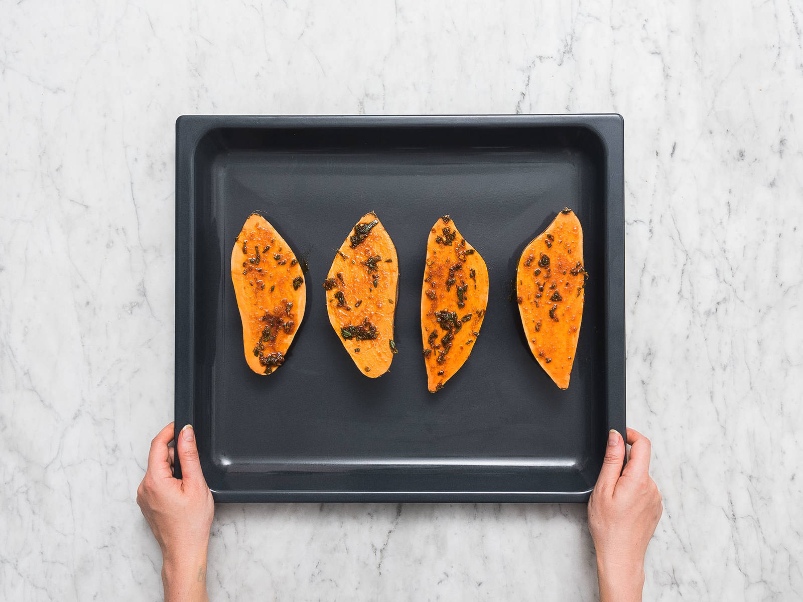 Halve sweet potatoes and brush with marinade. Transfer sweet potatoes to a parchement-lined baking sheet and bake at 220°C/425°F for approx. 15 min., or until fork-tender.