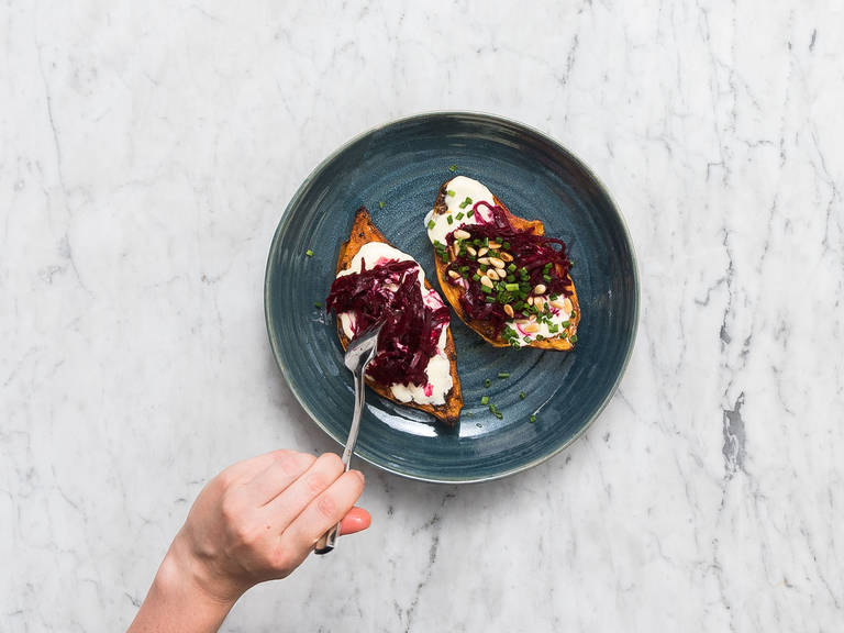 Remove sweet potatoes from oven and mash the inside with a fork. Top with mayonnaise, marinated beetroot, and toasted pine nuts. Garnish with chopped chives and enjoy!